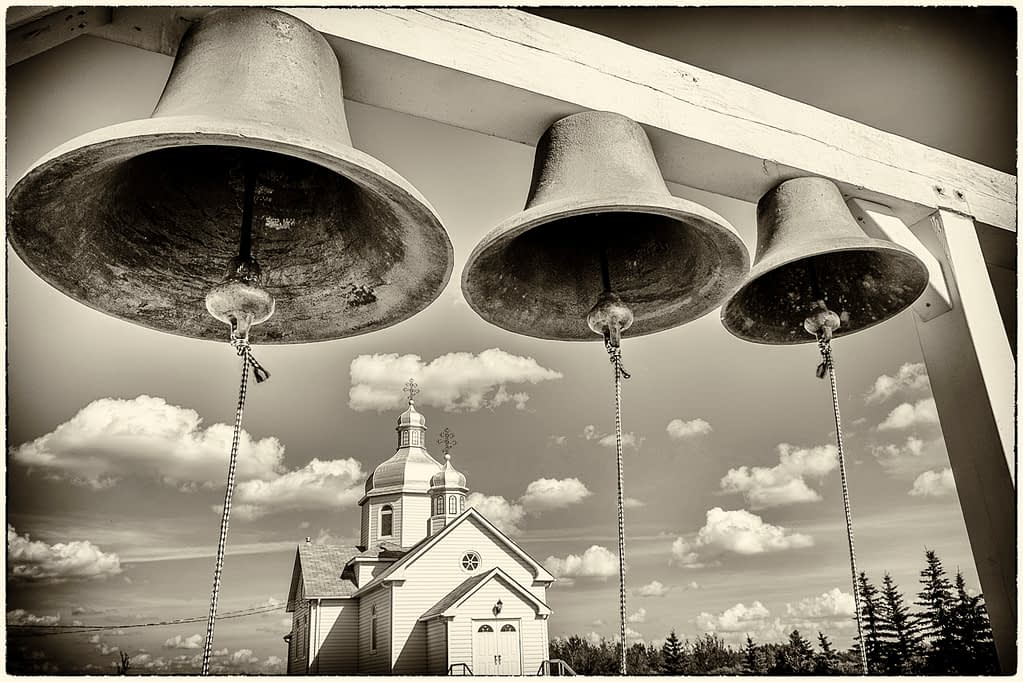Instead of a belfry, three church bells are fastened to a post just west of the church. The bells were donated by one of the early pioneer families.