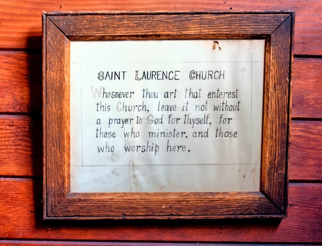 The framed invocation in the church vestibule.