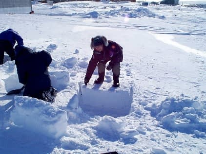 Alex T. cutting one of the first blocks for the igloo.