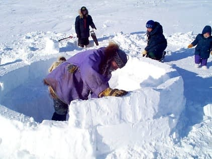 Doug adds to the spiral of snow blocks that eventually circle around to the top of the dome of the igloo.